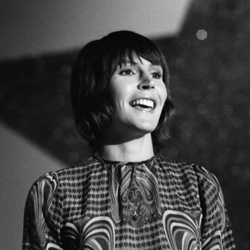 """Helen Reddy, October 25, 1941 - September 29, 2020, was an Australian-American musician. Her most famous song is """"I Am Woman."""" She got her start in music on the TV show Bandstand in 1966."""